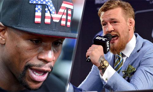 Conor McGregor (phải) thách Mayweather động tay chân thay vì đấu võ mồm. Ảnh: Fox.